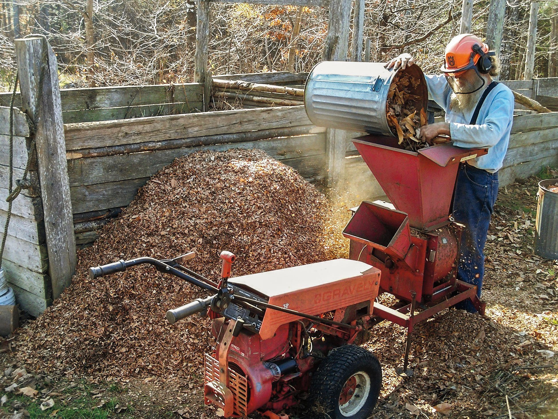 best leaf mulcher - equiped man operating leaf mulcher