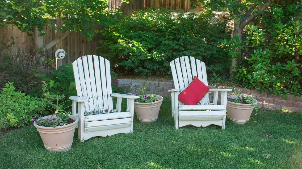 Kid Friendly Backyard Ideas-fill-the-backyard-chairs- in the grass