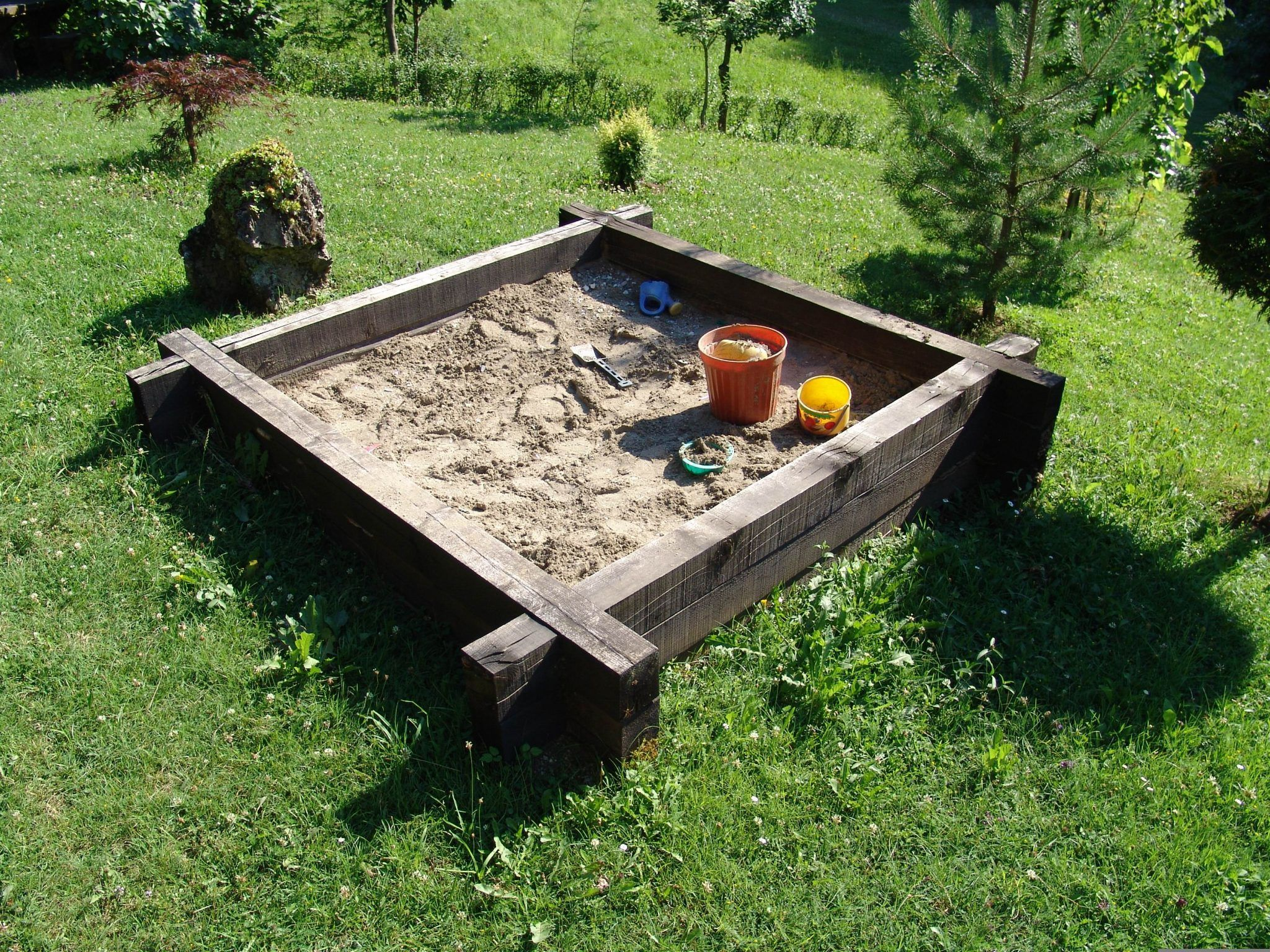 Kid Friendly Backyard Ideas-give your kids a sandbox-sandbox in the garden