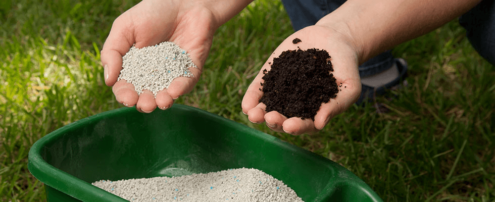 A person holding a bit of organic fertilizer in one hand and artificial fertilizer in the other