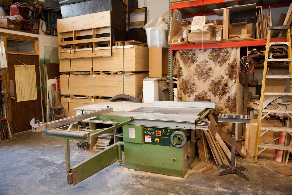 a woodworking shop with a cabinet table saw