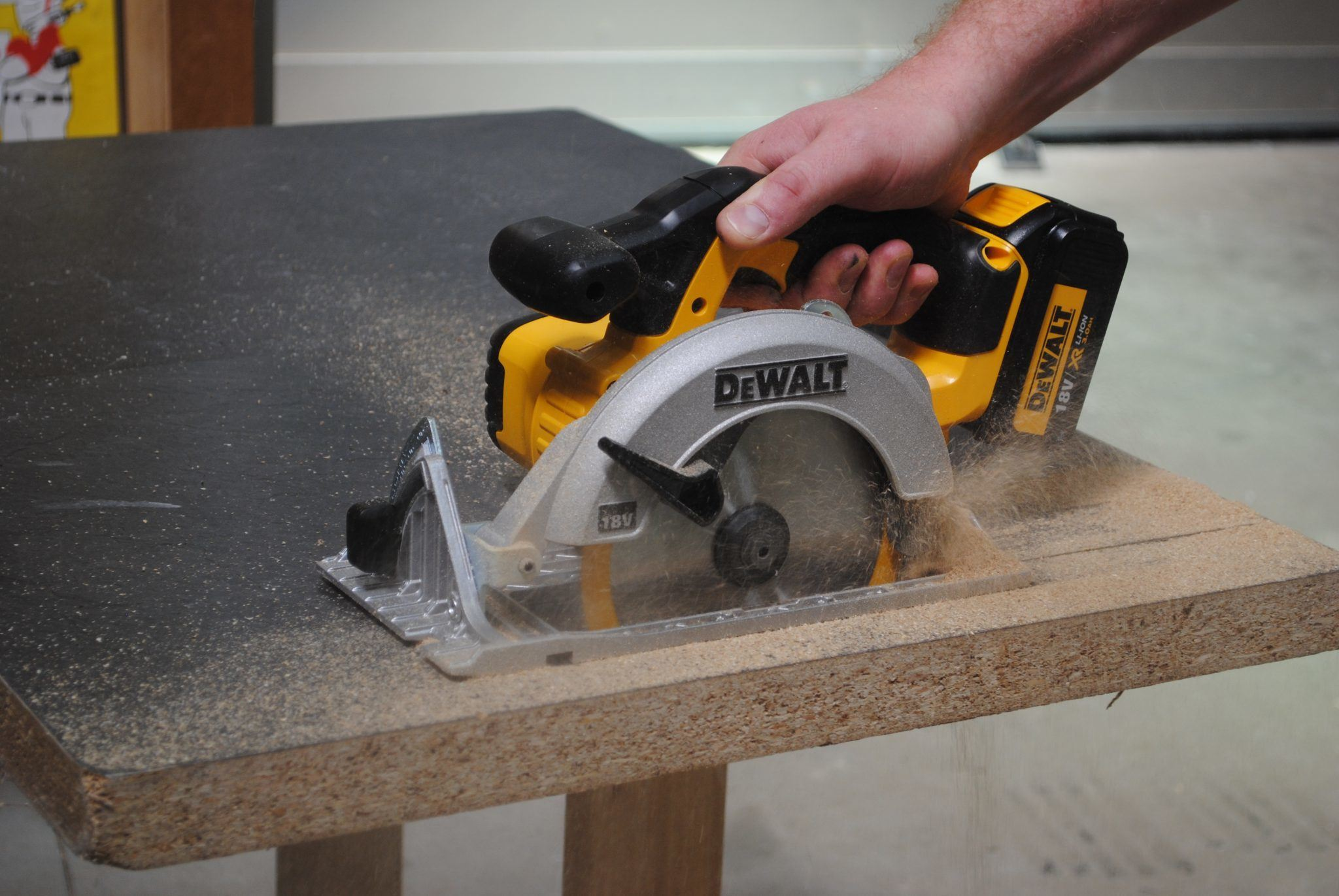 a woodworker cutting a board with a circular saw
